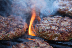 Lamb burgers flaming up on the Cuisinart CGG-200 Portable Gas Grill